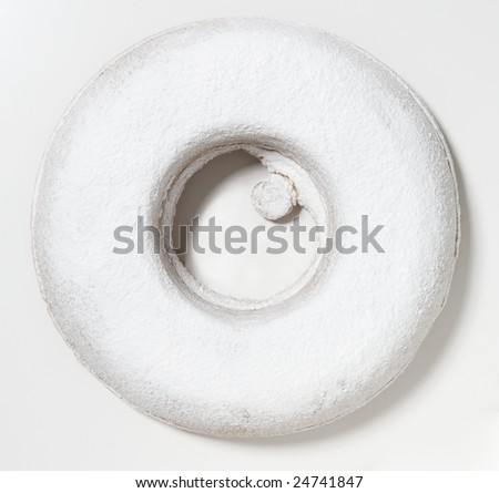 Big bread rings shaped cake icing sugar on white background