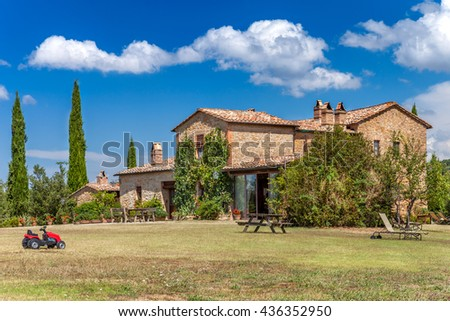 Big brick house in the countryside of Tuscany, Italy. Rural landscape. Rest zone. - stock photo
