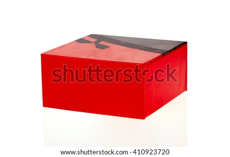 Big bright red box closed isolated on white background
