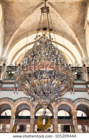 Big bronze chandelier in Church Of The Holy Sepulchre. Jerusalem. Israel - stock photo