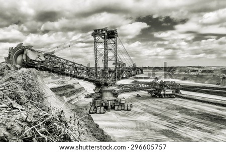 big brown coal wide-bucket excavator black and white photo