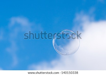 big bubble waiting to burst in blue summer sky - stock photo