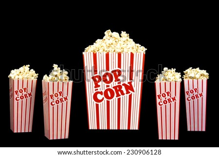 Big Bucket Of Popcorn and Four Small Buckets Of Popcorn On Black Background - stock photo