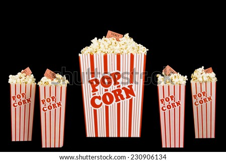 Big Bucket Of Popcorn With Small Boxes Of Popcorn With Movie Tickets On Black Background - stock photo