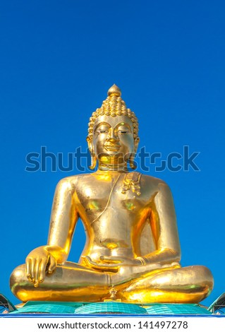 Big Buddha statue at Golden Triangle (Temple open to public to watch. Allowed to take photos in the temple. no restriction in copy or use) - stock photo
