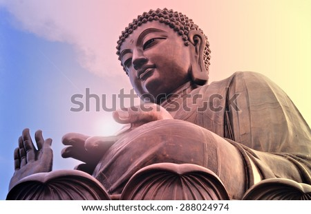 Big Buddha statue at Po Lin monastery Lantau island Hong Kong. Bright light source in hand. - stock photo