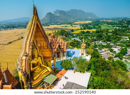 Big Buddha statue at Tiger Cave Temple (Wat Tham Sua), Kanchanaburi Province, Thailand - stock photo