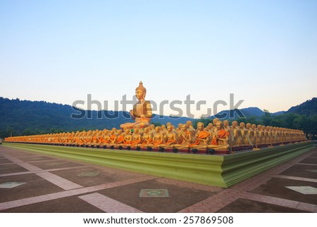 big buddha statue in buddhist religious temple with beautiful morning light against clear blue sky use for religion and related topic - stock photo
