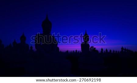 Big buddha statue in sunset background - stock photo