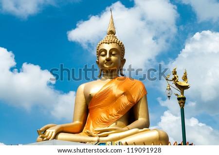 Big Buddha Statue with nice blue sky background. - stock photo