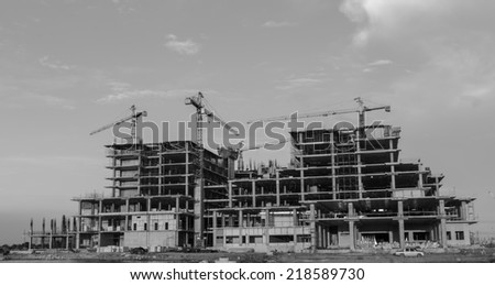 big building construction with crane - stock photo