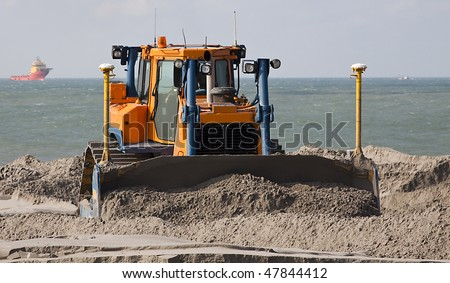 Big Bulldozer on a dredging project in holland - stock photo