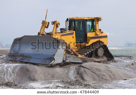 Big bulldozer on the beach