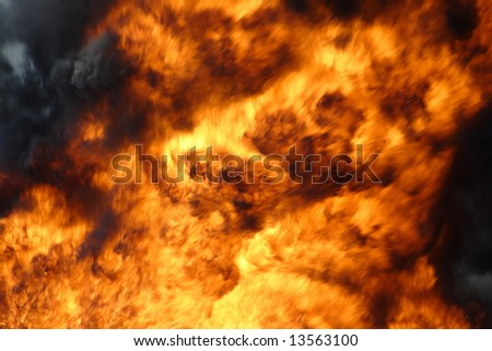 Big burning fire with black smoke - stock photo