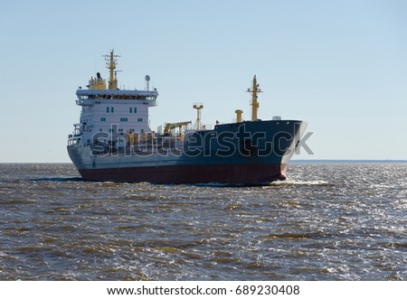 Big Cargo ship sailing in still water