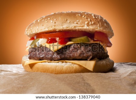 Big cheeseburger in low key technique - stock photo