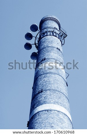 big chimney equipped with shoot lights in a factory