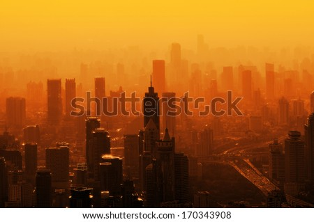 Big city in the fog - a view from the top - stock photo
