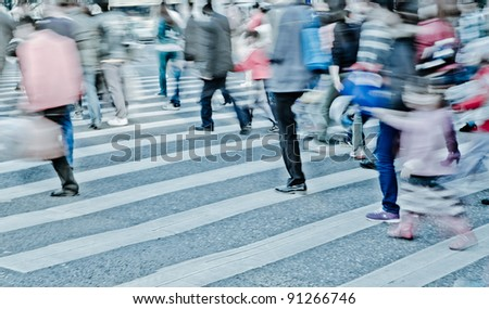 big city person crowd crossing street - stock photo