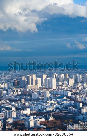 big city under high blue sky with white clouds
