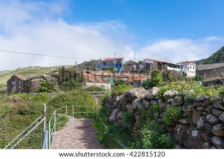 Big clouds above the village Arure on the Canary Island La Gomera. Arure is a hamlet and part of the Valle Gran Rey but situated outside the valley. Agriculture is the main yield of the population - stock photo