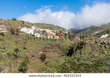 Big clouds above the village Arure on the Canary Island La Gomera. Clouds which form above regions within trade wind, comes from the Azores and reaches the Islands in approx. 800m altitude - stock photo