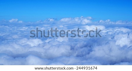 Big clouds and light beam  - stock photo