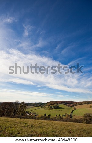 Big cloudy blue sky above an autumn landscape in Oxfordshire, England. Photo taken in late morning light. Space for your text. - stock photo