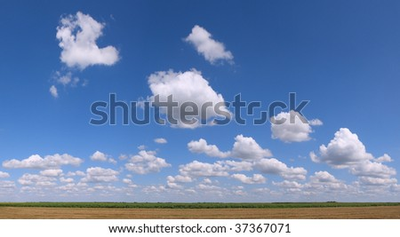 Big Cloudy Flat Ground Area Panorama - stock photo
