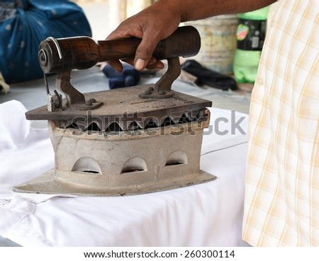 Big coal ironing equipment used in rural India for ironing clothes - stock photo