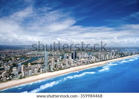 Big coastal city photographed from high above on a peaceful afternoon, surfers paradise - stock photo