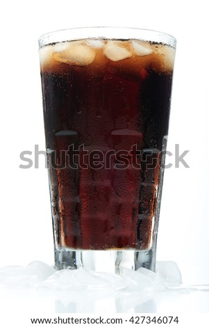 big cold glass of black soda with ice in and bottom - stock photo