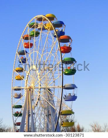 Big colorful ferris wheel over blue sky - stock photo