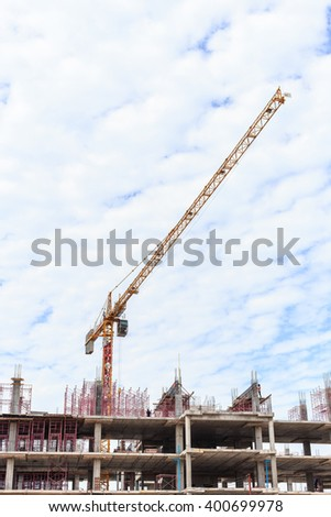 Big construction crane and the building against the sky background