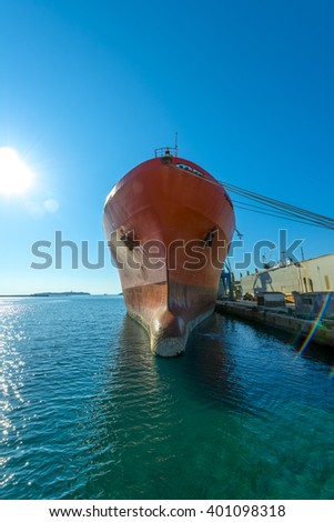 Big container ship on the dock. Close-up shot of the front part. - stock photo