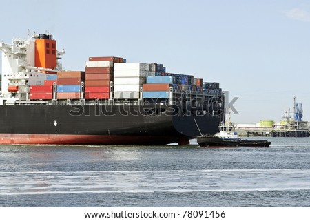 big container ship with pilot boat - stock photo