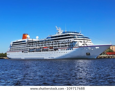 Big cruise liner in a city port - stock photo