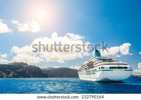 Big cruise liners near the Greek Islands. Santorini island, Greece - stock photo