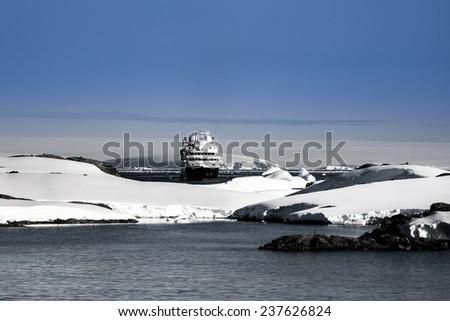 Big cruise ship in Antarctic waters - stock photo