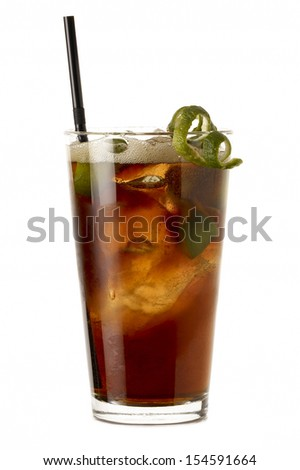 Big Cuba libre rum cocktail with lime isolated on white background
