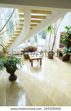 Big curly stairs in spacious front room