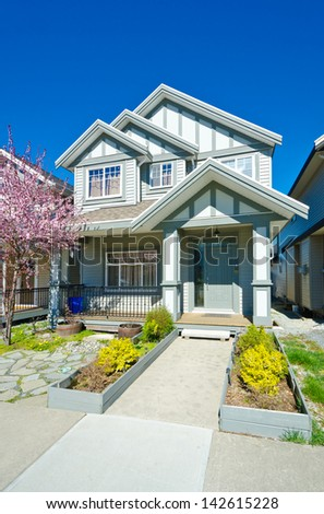 Big custom made cozy house with long doorway in the suburbs of Vancouver, Canada. - stock photo