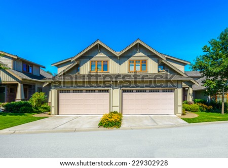 Big custom made luxury house, townhouse with garage  in the suburbs of Vancouver, Canada. - stock photo