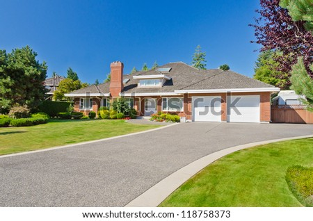 Big custom made luxury house with long doorway in the suburbs of Vancouver, Canada.