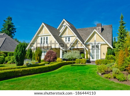 Big custom made luxury house with nicely landscaped front yard in the suburbs of Vancouver, Canada. - stock photo
