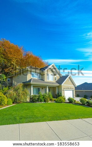 Big custom made luxury house with nicely landscaped front yard to in the suburbs of Vancouver, Canada.