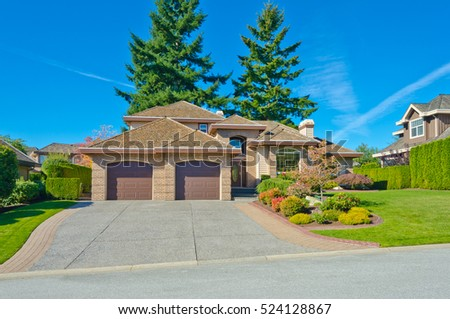 big custom made luxury house with nicely trimmed and landscaped front yard and driveway to garage - Big Nice House