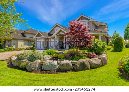 Beautiful home exterior evening sunset scene stock photo for Luxury landscape design