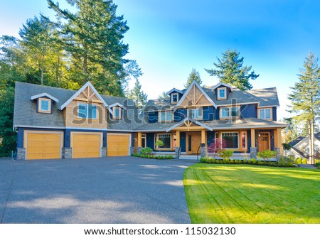 Big custom made triple doors garage luxury house in the suburbs of Vancouver, Canada. - stock photo
