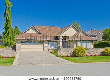 Big custom made with double doors garage luxury house in the suburbs of Vancouver, Canada. - stock photo